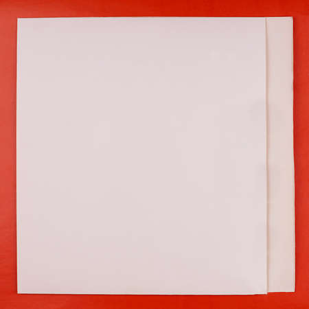 A white sheet of paper with a red border