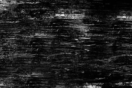The heavily scratched wood surface is black.Background or texture