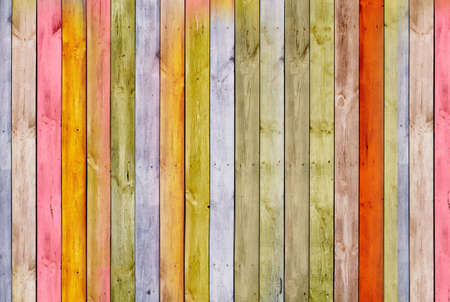 The wall is made of pine multi-color wooden Board. Texture or background Banco de Imagens