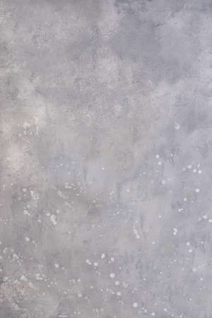 Splashes of white acrylic paint on the gray wall .Texture or background.