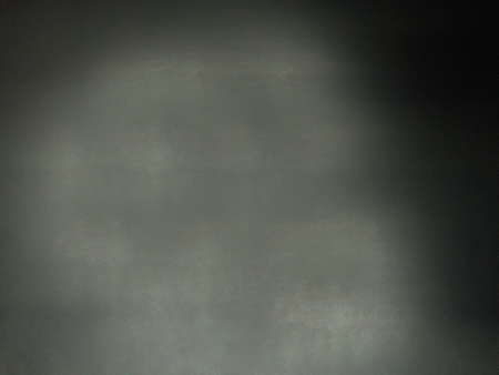 The rough empty surface of the wall is dark gray.Texture or background