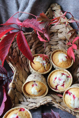 Homemade cupcakes with cherry filling decorated with autumn leaves