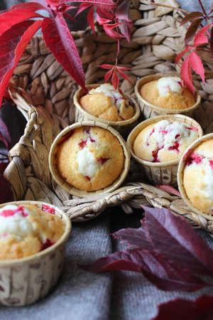Cupcakes with cherry filling decorated with leaves Banco de Imagens