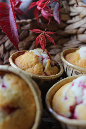 Homemade cupcakes in a star shaped basket and decorated with autumn foliage .Texture or background Banco de Imagens