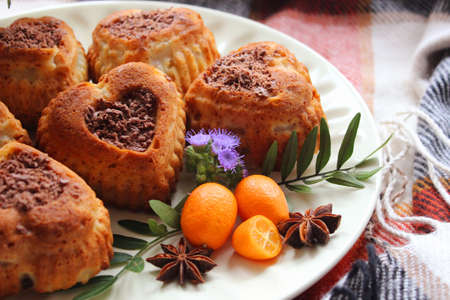 Homemade cakes with grated chocolate and decorated with tangerines