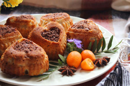 Homemade heart shaped pastries decorated with grated chocolate