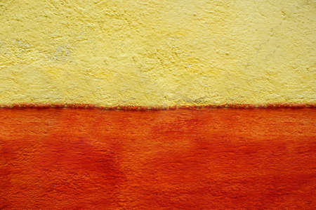 Two color horizontally divided plastered wall yellow orange color Banco de Imagens