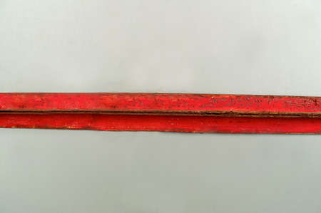 Horizontal metal rusty plate of red color on a light background Archivio Fotografico