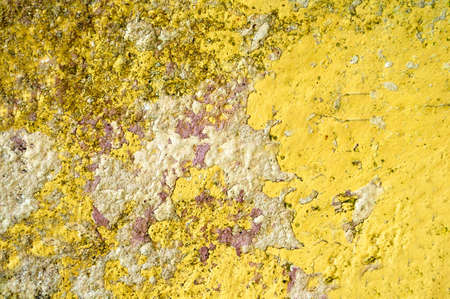 The old wall surface is yellow with irregularities and roughness Archivio Fotografico