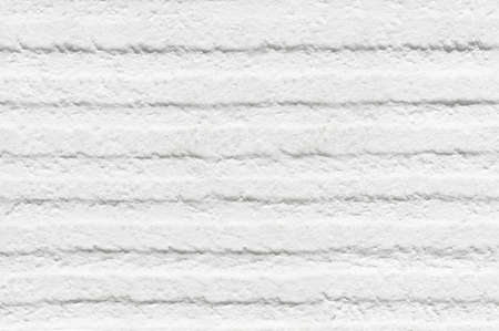 White wall with indentations and roughness on the surface and for texture or background