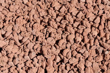 Expanded clay granules close-up of brown color.Texture or background