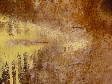 A rusty iron plate with a yellow paint stain Archivio Fotografico