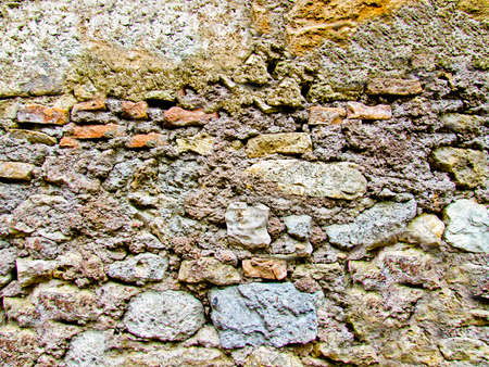 Background texture of an antique stone wall close-up Archivio Fotografico