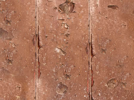 Exfoliating old brown paint with wood surface close-up Archivio Fotografico
