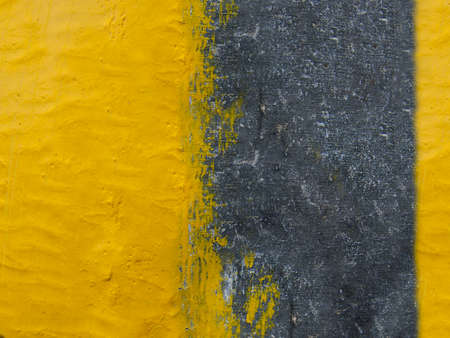 Background of an old yellow painted wall close-up