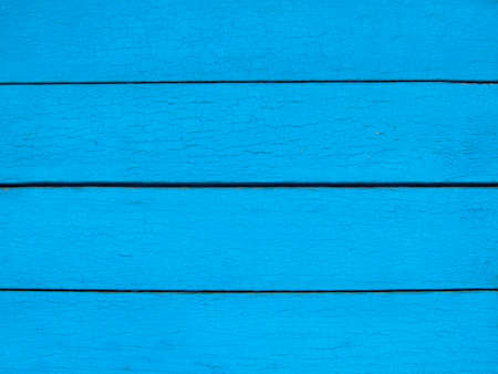 A horizontally laid board with a textured surface of light blue color Archivio Fotografico