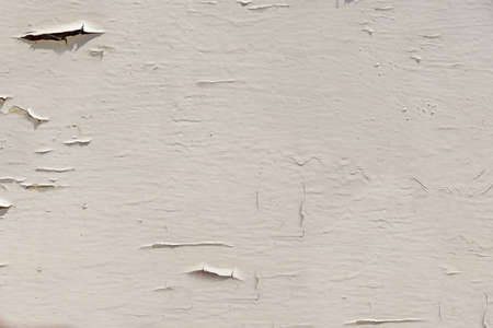 Peeling beige paint from the wall surface close-up Archivio Fotografico