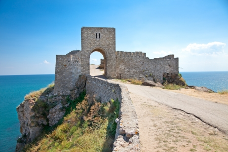 Old gate guarding the entrance in the medieval fortress on cape Kaliakra, Bulgaria