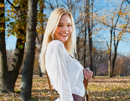 Beautiful woman enjoying in the autumn colored park Banco de Imagens - 17850423