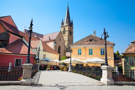 Historical architecture in Sibiu  Old bridge, medieval houses and church tower in background  Transylvania, Romania    Stock Photo