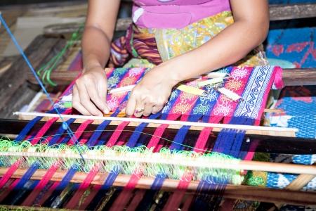 indonesia culture: Sasak tribe lady weaving, Sade, Lombok, Indonesia Stock Photo