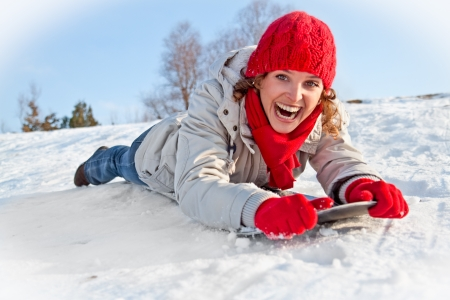 Happy young snowboard girl  on the snow sunny day photo