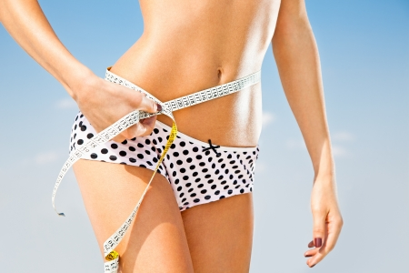 women body: Woman measuring perfect shape of beautiful hips  Healthy lifestyles concept Stock Photo