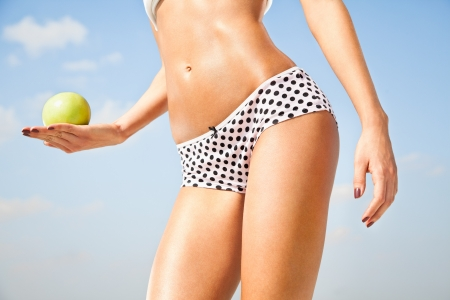 Woman perfect slim body holding an apple   Diet, healthy life