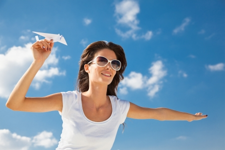 Young caucasian girl with two paper plane in the hand photo