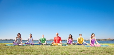 yoga meditation: Group of young people have meditation on yoga class  Yoga concept