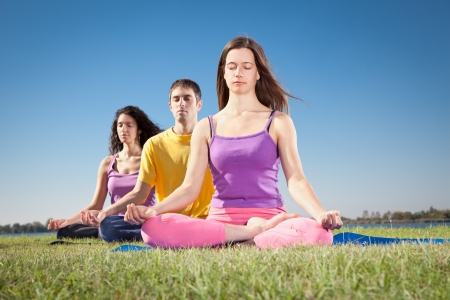 Group of young people have meditation on yoga class  Yoga concept