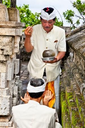 workship: BALI-JANUARY 14:People praying in temple Pura Luhur Uluwatu on January 14, 2010 in Bali,Indonesia. Pura LuhurUluwatu is known as the guardian of the southwest and dedicated to the spirits of the sea.  Editorial