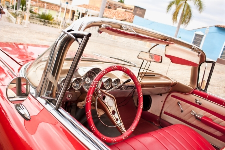 oldtimer: Detail of  Red Classic Chevrolet in the central square of Trinidad, Cuba. Stock Photo