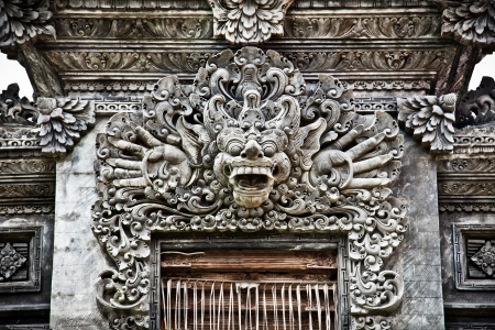 Stone sculpture on entrance door of Pura Padmasana Puja Mandala. Nusa Dua, Bali . Indonesia  photo