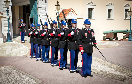 happens: MONACO - MARCH 23: The military force performing the Change of Guard, March 23, 2014 in Monaco. The event happens daily at the Place du Palais at 11:55am