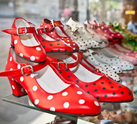 Flamenco dancing shoes or gypsy shoes with polka dot spots in shop market, Seville, Spain.