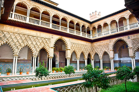 Courtyard with water pool of Alcazar, Seville, Andalusia, Spain