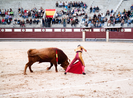 MADRID - OCTOBER 17:?The matadors fancy footwork, skill and bravery before the bull that has the crowd in raptures, Plaza del Toros de Las Venta on october 17, 2010., Madrid, Spain.