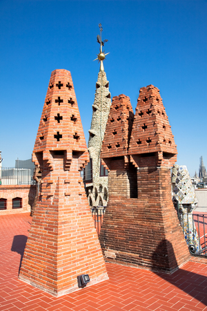 BARCELONA, SPAIN - 2 OCTOBER:The chimneys and conical vents remembering small fir trees on roof of Palaus G?ell house, Gaudis most important masterpieces on october 02, 2011 in Barcelona, Spain Editorial