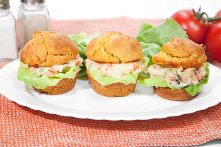 Tree cakes filled with russian salad and  lettuce serve on plate Stockfoto
