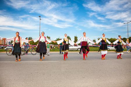 NOVI SAD, SERBIA-OCT 4, 2015: Guinness World Record Largest Folk Dance on Oct 4. 2015 in Novi Sad, Serbia. Over 12.000 participants break the Guinness World Record by simultaneously dancing a Kolo Editorial