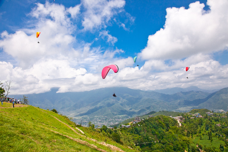 Paraglider flying against the Himalayas-Everest region, Nepal.