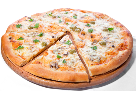 Tasty vegetable pizza made from bio cheese, tomato, olive, mushroom, parsley