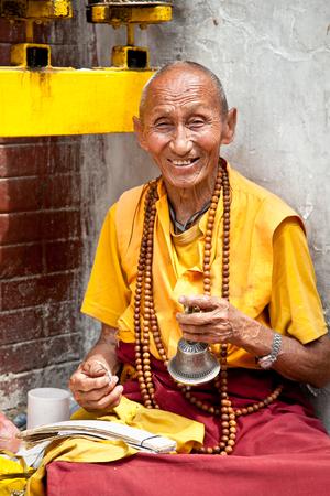 KATHMANDU, NEPAL - MAY 18: Unidentified buddhist monk is praying in Bouddanath Stupa on May 18, 2013 in Kathmandu, Nepal.
