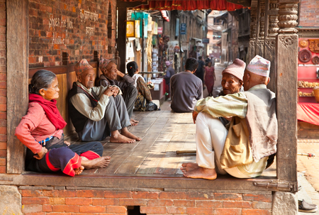 BHAKTAPUR - MAY 20 : Unidentified Tharu old people besides the street of Bhaktapur, Nepal on May 20, 2013. Tharu are an ethnic group from west part of Nepal. Editorial