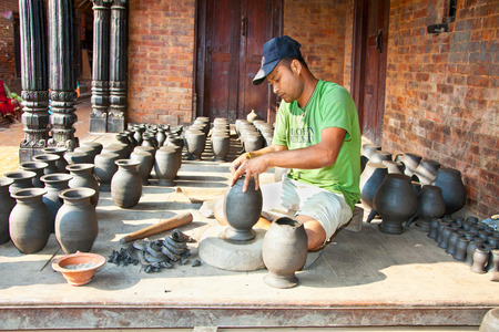 BHAKTAPUR, NEPAL - MAY 20 : Unidentified man is molding the pot on May 20, 2013 in Bhaktapur, Nepal.