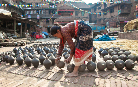 BHAKTAPUR, NEPAL - MAY 20: Unidentified woman is molding the pot on May 20, 2013 in Bhaktapur, Nepal. Editorial