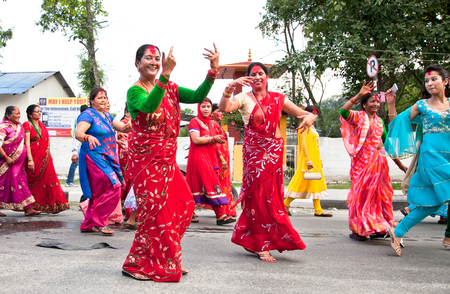 POKHARA, NEPAL-MAY 25. 2013: An unidentified Nepalese women dancing in traditional cloths during the nepal public holidey Buddha Jayanty on May 25, 2013 in Pokhara, Nepal. Editorial