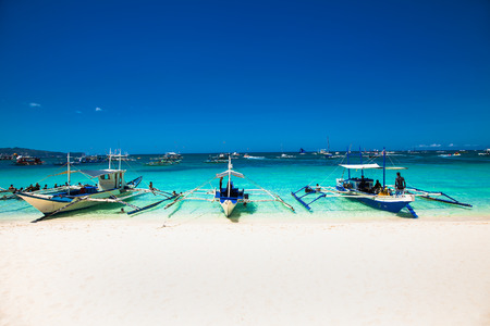 Diving's boat at famous White Beach on Boracay Island, Philippines. Stock fotó