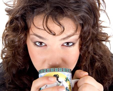 Beautiful brunette drinking hot ceylon tea